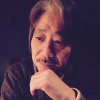 西野 哲雄 氏